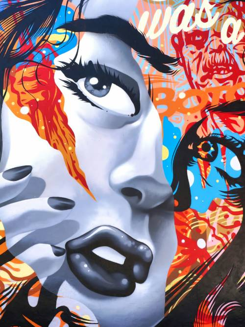Artistic graffiti of woman wallpaper