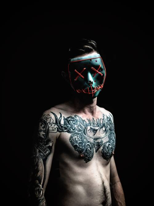 Tattooed man with mask wallpaper